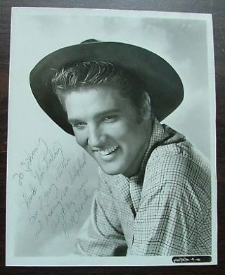 Elvis Presley - 8x10 black and white photograph from the movie Love Me Tender, inscribed and signed. Fine condition. Archivally framed with museum glass.