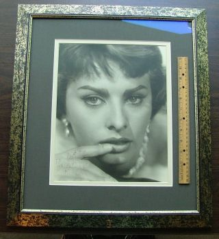 "Sophia Loren - Signed 11"" x 14"" matte f inish, close up photo, framed. Fine condition."